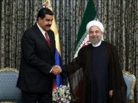 TEHRAN, IRAN - OCTOBER 22: Iranian President Hassan Rohani (R) shakes hands with Venezuelan President Nicolas Maduro (L) at Sadabad Complex in Tehran, Iran on October 22, 2016. (Photo by Pool / Iran Presidency/Anadolu Agency/Getty Images)