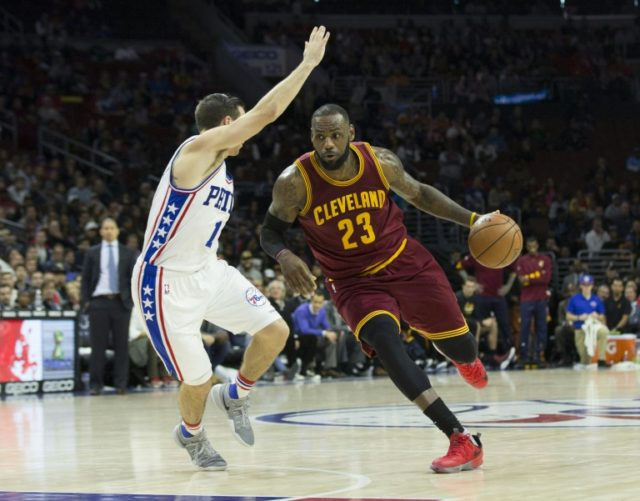 LeBron James of the Cleveland Cavaliers drives to the basket against T.J. McConnell #1 of the Philadelphia 76ers in the fourth quarter at Wells Fargo Center on November 27, 2016 in Philadelphia, Pennsylvania