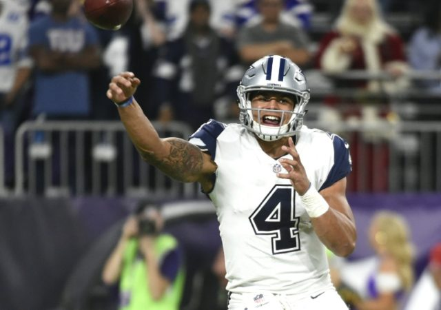 Dak Prescott of the Dallas Cowboys passes the ball in the third quarter of the game against the Minnesota Vikings at US Bank Stadium in Minneapolis, Minnesota