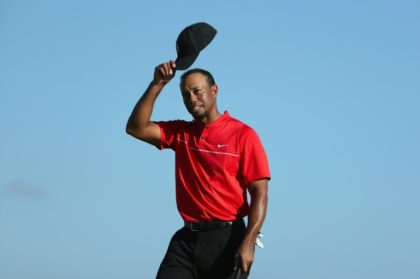 Tiger Woods of the United States tips his cap on the 18th hole during the final round of the Hero World Challenge