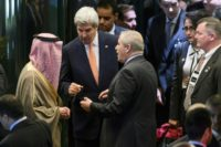 US Secretary of State John Kerry (C) speaks to Saudi Arabia's Foreign Minister Adel al-Jubeir (L) and Jordan's FM Nasser Judeh at the end of Syria peace talks in Lausanne, in October 2016