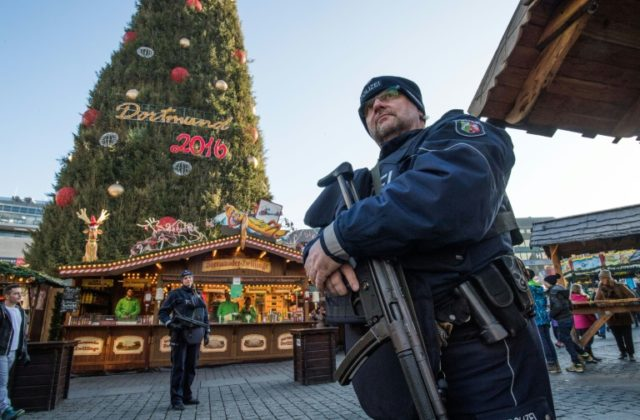 Police patrol at a Christmas market in Dortmund, western Germany, on December 20, 2016 as part of enhanced security measures