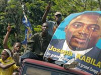 Supporters of DR Congo President Joseph Kabila parade his photograph in Kinshasa in November 2006