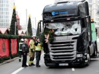 German officials inspect the truck that Anis Amri drove through a packed Berlin Christmas market on December 19, 2016