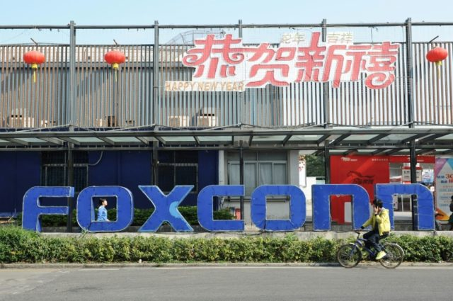 Foxconn, a major Apple supplier, will spend the vast sum on an industrial complex in the sprawling southern Chinese city of Guangzhou, state media says