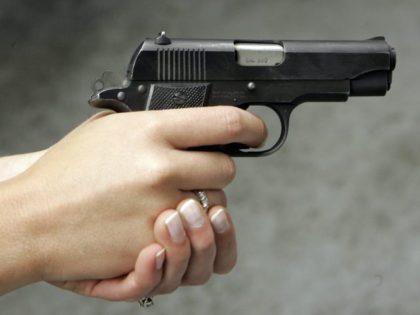 woman-pointing-handgun-David-Duprey-AP