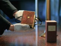 Curator Clark Evans displays the burgundy velvet, gilt-edged Lincoln Inaugural Bible at the Library of Congress Tuesday, Dec. 23, 2008, in Washington. President-elect Barack Obama will take his oath of office on the bible Jan. 20, becoming the first president to use it since Abraham Lincoln at his swearing-in on …
