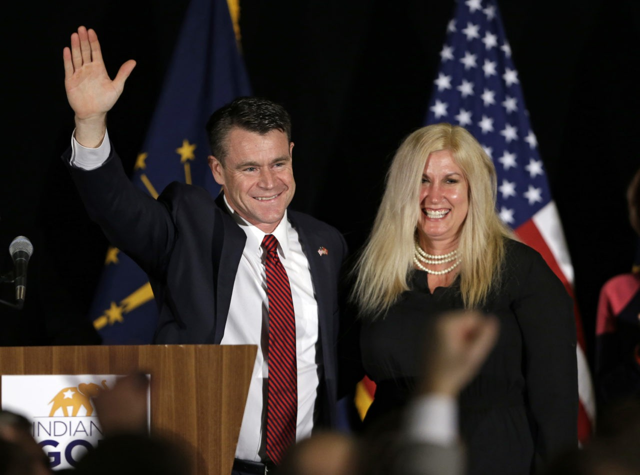 Sen.-elect. Todd Young, R-Ind., accompanied by his wife Jenny, celebrates winning his race, as he thanks supporters at an election night rally in Indianapolis, Tuesday, Nov. 8, 2016. (AP Photo/Michael Conroy)
