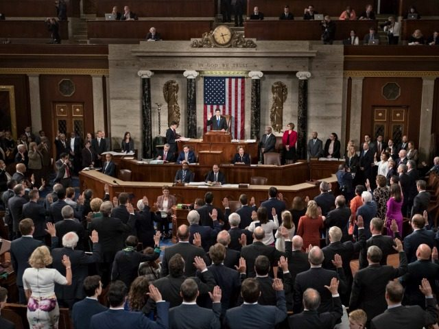 Speaker of the House Paul Ryan, R-Wis., administers the oath to the members of the House of Representatives as the 115th Congress convenes at the Capitol in Washington, Tuesday, Jan. 3, 2017. With the GOP now in control of the White House, the Senate, and the House, Republicans are expected …