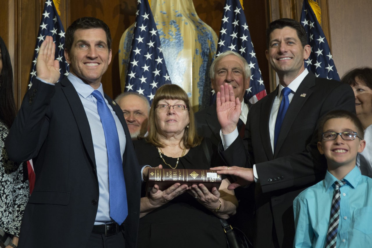 House Speaker Paul Ryan of Wis. administers the House oath of office to Rep. Scott Taylor, R-Va., during a mock swearing in ceremony on Capitol Hill in Washington, Tuesday, Jan. 3, 2017. (AP Photo/Zach Gibson)