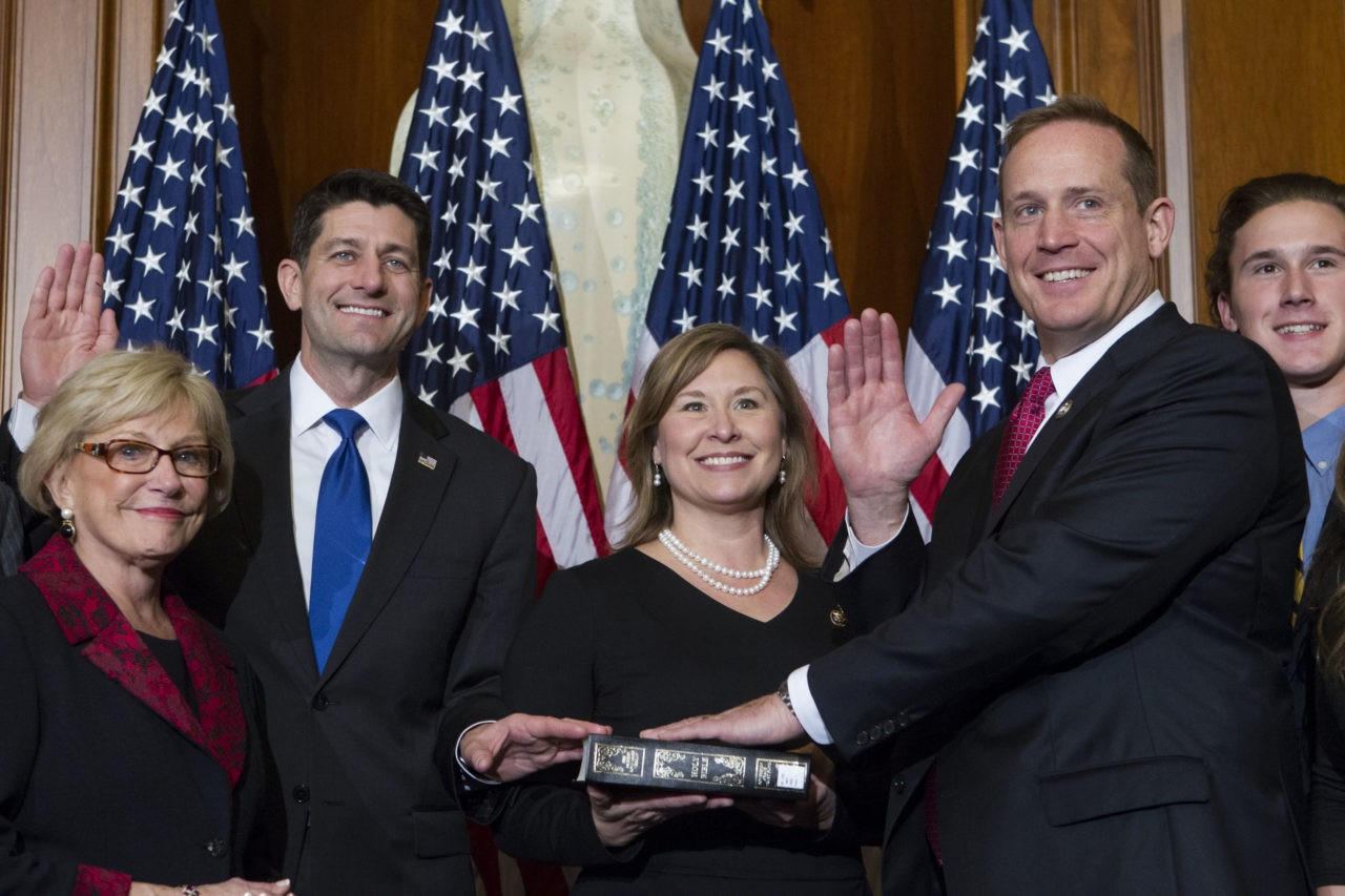 House Speaker Paul Ryan of Wis. administers the House oath of office to Rep. Ted Budd, R-N.C., during a mock swearing in ceremony on Capitol Hill in Washington, Tuesday, Jan. 3, 2017. (AP Photo/Jose Luis Magana)