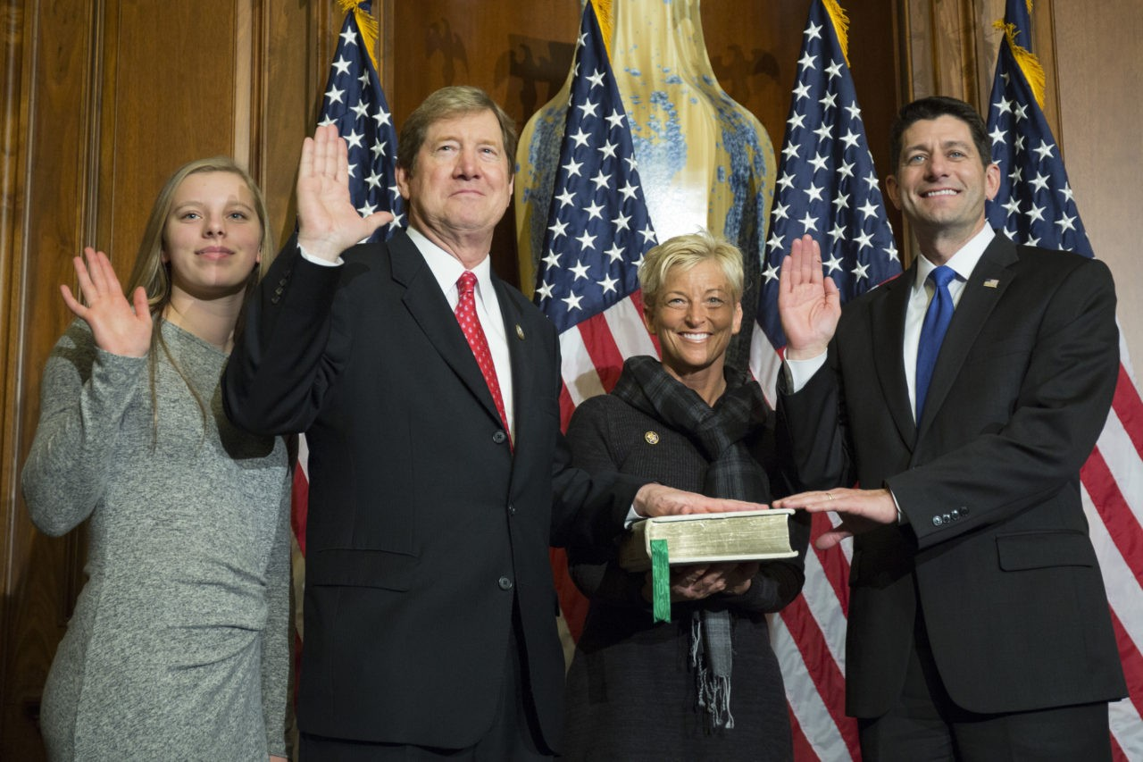 House Speaker Paul Ryan of Wis. administers the House oath of office to Rep. Jason Lewis, R-Minn., during a mock swearing in ceremony on Capitol Hill in Washington, Tuesday, Jan. 3, 2017. (AP Photo/Zach Gibson)
