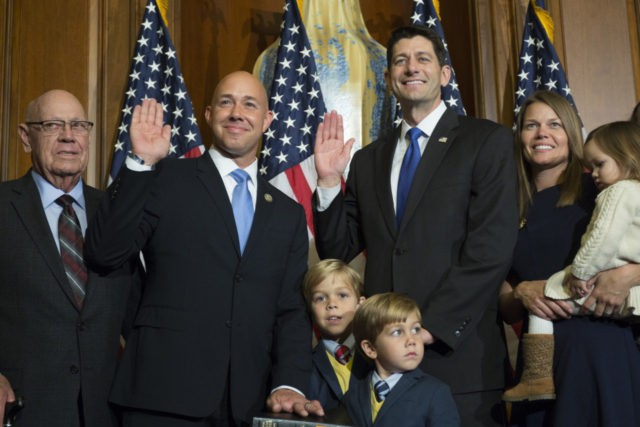 House Speaker Paul Ryan of Wis. administers the House oath of office to Rep. Brian Mast, R-Fla., during a mock swearing in ceremony on Capitol Hill in Washington, Tuesday, Jan. 3, 2017. (AP Photo/Zach Gibson)