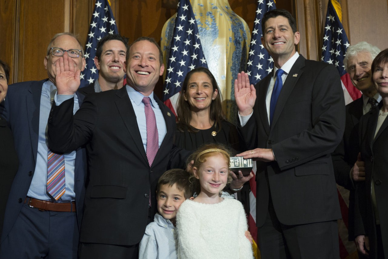 House Speaker Paul Ryan of Wis. administers the House oath of office to Rep. Josh Gottheimer, D-N.J., during a mock swearing in ceremony on Capitol Hill, Tuesday, Jan. 3, 2017, in Washington. (AP Photo/Zach Gibson)