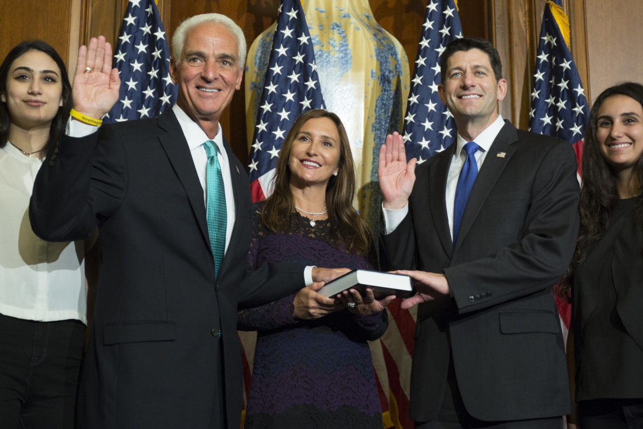 House Speaker Paul Ryan of Wis. administers the House oath of office to Rep. Charlie Crist, D-Fla., during a mock swearing in ceremony on Capitol Hill, Tuesday, Jan. 3, 2017, in Washington. (AP Photo/Zach Gibson)