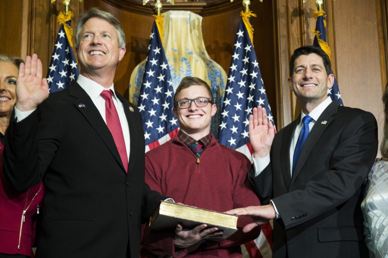 House Speaker Paul Ryan of Wis. administers the House oath of office to Rep. Roger Marshall, R-Kan., during a mock swearing in ceremony on Capitol Hill in Washington, Tuesday, Jan. 3, 2017, as the 115th Congress began. (AP Photo/Zach Gibson)