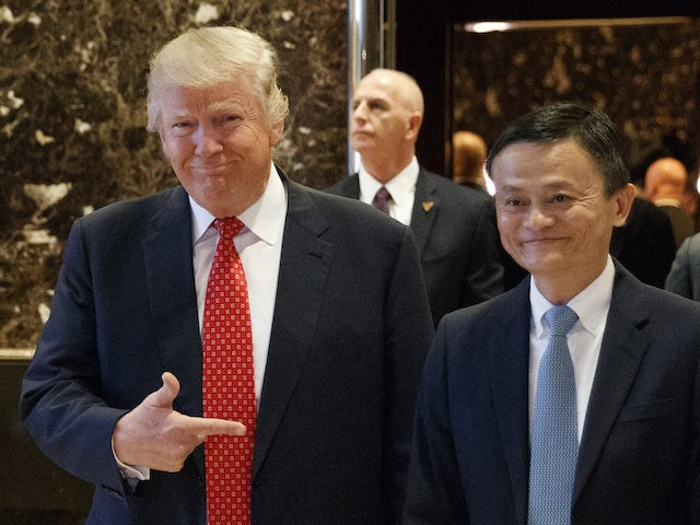 President-elect Donald Trump stands with Alibaba Executive Chairman Jack Ma as they walk to speak with reporters after a meeting at Trump Tower in New York, Monday, Jan. 9, 2017. (AP Photo/Evan Vucci)