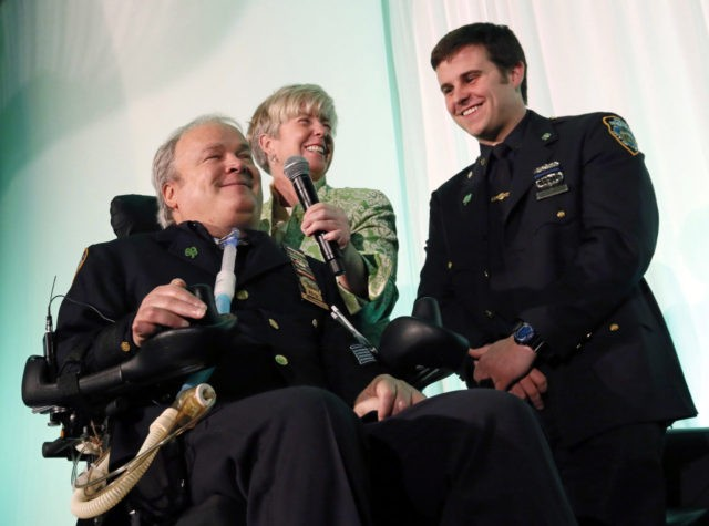 FILE - In this March 15, 2015 file photo, New York City Detective Steven McDonald, his wife Patti, and son, Conor, smile after receiving the Spirit of Giving Award at the Kelly Cares Foundation's 5th Annual Irish Eyes Gala held at the JW Marriot Essex House in New York. McDonald, …