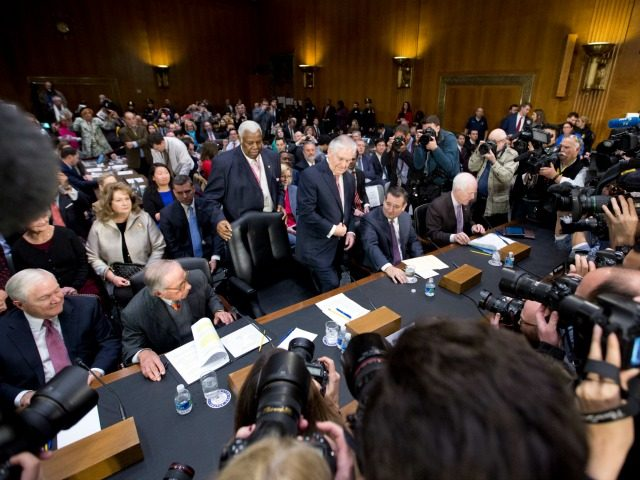 Secretary of State-designate Rex Tillerson, center, accompanied by, from left, former Defense Secretary Robert Gates, former Georgia Sen. San Nunn, Sen. Ted Cruz, R-Texas, and Senate Majority Whip John Cornyn of Texas, takes his seat on Capitol Hill in Washington, Wednesday, Jan. 11, 2017.