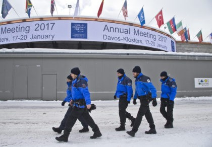Swiss police officers walk past the congress center where the annual meeting, World Economic Forum, will take place in Davos, Switzerland, Sunday Jan. 15, 2017. Business and world leaders are gathering for the annual meeting in Davos. (AP Photo/Michel Euler)(AP Photo/Michel Euler)