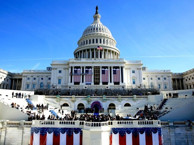 The U.S. Capitol looms over a stage during a rehearsal of the President-elect Donald Trump's swearing-in ceremony, Sunday, Jan. 15, 2017, in Washington. (AP Photo/Patrick Semansky)