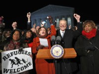 Rep. Sheila Jackson Lee D-Texas, left, House Minority Leader Nancy Pelosi of Calif., Senate Minority Leader Chuck Schumer of New York, Rep. Brenda Lawrence, D-Mich., right, and other members of Congress, hold small candles aloft in front of the Supreme Court during a news conference about President Donald Trump's recent executive orders, Monday, Jan. 30, 2017 in Washington. (AP Photo/Alex Brandon)