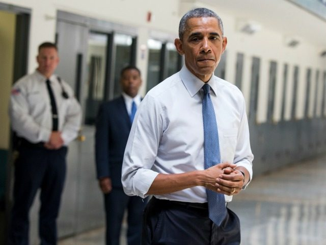 July 16, 2015, file photo, President Barack Obama pauses as he speaks at the El Reno Federal Correctional Institution in El Reno, Okla.