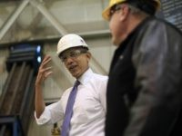 President Barack Obama gestures about wearing a hardhat and safety goggles during his tour at ArcelorMittal, a steel mill in Cleveland, Thursday, Nov. 14, 2013. Obama visited the steel mill to discuss the economy and manufacturing. From Ohio the president will travel to Philadelphia to raise campaign money benefiting the …