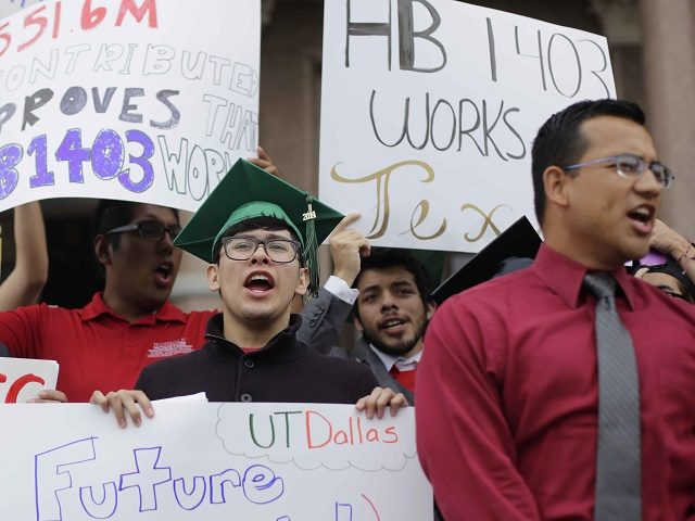 Students rally on the steps of the Texas Capitol to support House Bill 1403 which allows students regardless of their immigration status to qualify for in-state tuition at public colleges and universities if they meet the requirements, Thursday, May 21, 2015, in Austin, Texas. (AP Photo/Eric Gay)