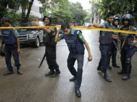 Bangladeshi policemen stand guard in an area cordoned off after heavily armed militants struck at the heart of Bangladesh's diplomatic zone on Friday night, in Dhaka, Bangladesh, Saturday, July 2, 2016. Bangladeshi forces stormed the popular Holey Artisan Bakery in Dhaka's Gulshan area to end a hostage-taking early Saturday. (AP …
