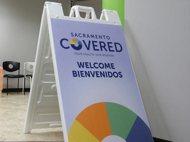 FILE - In this Feb. 12, 2015 file photo Laura San Nicolas, right, and her daughter Geena, wait to meet with an enrollment counselor to sign up for health insurance at Sacramento Covered in Sacramento, Calif. California's Democratically controlled government is looking at a defensive future under President-elect Donald Trump …
