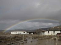 California rain drought rainbow flood (Marcio Jose Sanchez / Associated Press)