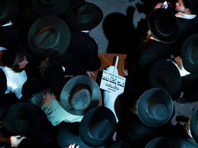 Ultra-orthodox Jewish mourners carry the body of three-month-old baby Chaya Zissel Braun during her funeral in Jerusalem on October 23, 2014 after she was killed in what Israeli police called a 'hit-and-run terror attack' when a Palestinian driver rammed a group of pedestrians. Nine others were injured in the attack. …
