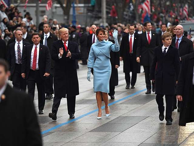 US President Donald Trump and First Lady Melania walk the inaugural parade route on Pennsylvania Avenue in Washington, DC, on January 20, 2107 following swearing-in ceremonies on Capitol Hill earlier today. (Photo: JIM WATSON/AFP/Getty Images)