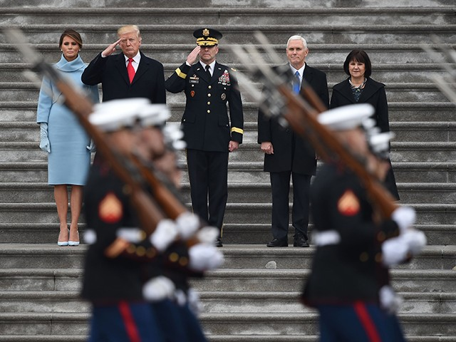 L-R: First Lady of the US Melania Trump, President Donald Trump, US Army Maj. General Bradley Becker, Vice President Mike Pence and Karen Pence look on at the start of the inaugural parade at the US Capitol January 20, 1017 in Washington, DC. (Photo: ROBYN BECK/AFP/Getty Images)