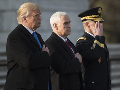 US President-elect Donald Trump and Vice President-elect Mike Pence take part in a wreath-laying ceremony at Arlington National Cemetery in Arlington, Virginia on January 19, 2017. (Photo: MANDEL NGAN/AFP/Getty Images)