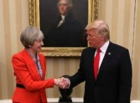 British Prime Minister Theresa May and U.S. President Donald Trump in The Oval Office at The White House on January 27, 2017 in Washington, DC. British Prime Minister Theresa May is on a two-day visit to the United States and will be the first world leader to meet with President Donald Trump.