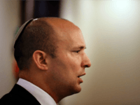 Israeli Education Minister Naftali Bennett (C) who heads the religious nationalist Jewish Home party speaks during a press conference for foreign press association correspondents in Jerusalem on November 14, 2016. Israel's ministerial committee for legislation approved a controversial draft bill aimed at legalising wildcat Jewish settlements built on private Palestinian …