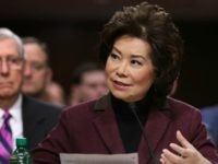 Elaine Chao testifies during her confirmation hearing to be the next U.S. secretary of transportation before the Senate Commerce, Science and Transportation Committee as her husband, Senate Majority Leader Mitch McConnell (R-KY) (L) looks on, in the Dirksen Senate Office Building on Capitol Hill January 11, 2017 in Washington, DC. …