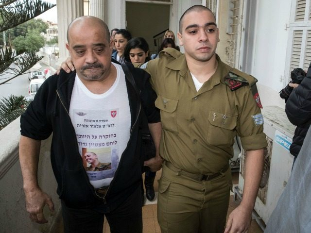 Israeli soldier Elor Azaria (R), who was caught on video shooting a wounded Palestinian assailant in the head as he lay on the ground, arrives with his father for a hearing at a military appeals court in Tel Aviv on November 23, 2016. / AFP / JACK GUEZ (Photo credit …