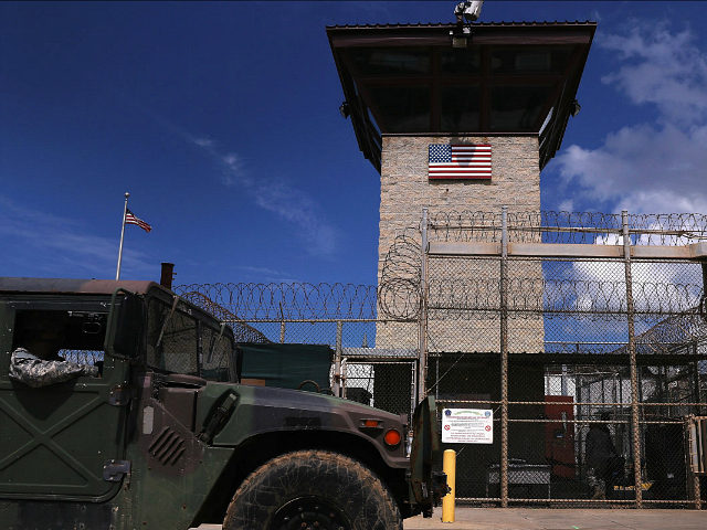 GUANTANAMO BAY, CUBA - OCTOBER 23:(EDITORS NOTE: Image has been reviewed by the U.S. Military prior to transmission.) A humvee passes the guard tower guard tower at the entrance of the U.S. prison at Guantanamo Bay, also known as 'Gitmo' on October 23, 2016 at the U.S. Naval Station at …
