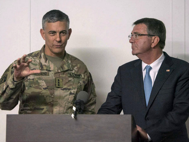 In this photo provided by the Defense Department, taken Oct. 23, 2016, Defense Secretary Ash Carter listens as U.S. Army Lt. Gen. Stephen Townsend, commander of Combined Joint Task Force-Operation Inherent Resolve, speaks during a news conference in Erbil, Iraq. Townsend, the commander of the U.S.-led coalition against the Islamic …