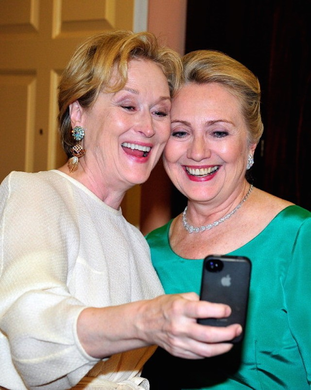 WASHINGTON, DC - DECEMBER 1: Meryl Streep takes a photo of herself with U.S. Secretary of State Hillary Clinton following a dinner for Kennedy honorees hosted by U.S. Secretary of State Hillary Rodham Clinton at the U.S. Department of State on December 1, 2012 in Washington, DC. The 2012 honorees are Buddy Guy, actor Dustin Hoffman, late-night host David Letterman, dancer Natalia Makarova, and members of the British rock band Led Zeppelin Robert Plant, Jimmy Page, and John Paul Jones. (Photo by Ron Sachs - Pool/Getty Images)