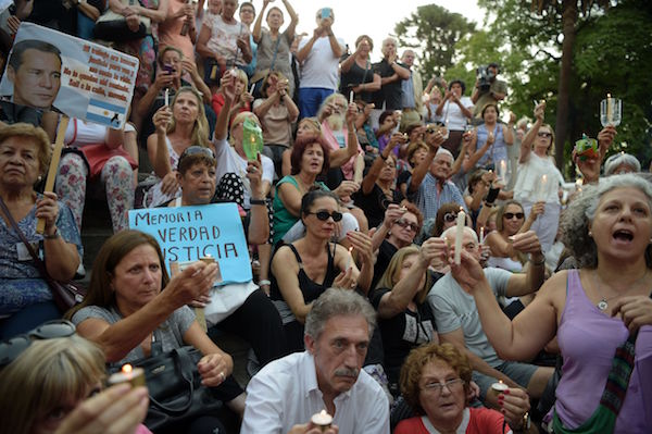 People take part in a vigil on the first anniversary of Argentinian prosecutor Alberto Nisman's mysterious death in Buenos Aires, on January 18, 2016. The prosecutor died in mysterious circumstances in January 18, 2015, after accusing Argentina's then president, Cristina Fernandez de Kirchner, of obstructing his investigation of a 1994 bombing at a Buenos Aires Jewish center. AFP PHOTO/EITAN ABRAMOVICH. / AFP / EITAN ABRAMOVICH (Photo credit should read EITAN ABRAMOVICH/AFP/Getty Images)