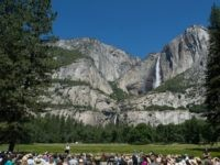President Barack Obama speaks in front of Cook's Meadow and Yosemite Falls on June 18, 2016 in Yosemite National Park, California. Obama is marking the centennial of the National Park Service which began on August 25, 1916. (Photo by)