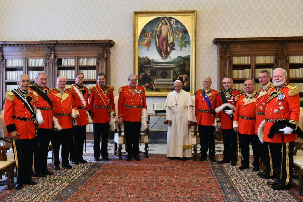Pope Francis poses with Robert Matthew Festing, Prince and Grand Master of the Sovereign Order of Malta and his delegation during a private audience on June 23, 2016 at the Vatican. / AFP / POOL / GABRIEL BOUYS        (Photo credit should read GABRIEL BOUYS/AFP/Getty Images)