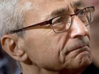 John Podesta, Clinton campaign chairman who believes his elitist strategy only lost because of Russian hacking, listens as former Democratic US Presidential candidate Hillary Clinton speaks to supporters at the New Yorker Hotel after her defeat in the presidential election November 9, 2016 in New York. / AFP / Brendan …