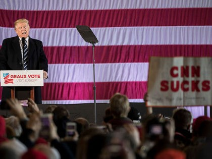 """BATON ROUGE, LA - DECEMBER 9: A sign reading """"CNN SUCKS"""" is held up as President-elect Donald Trump speaks at the Dow Chemical Hangar, December 9, 2016 in Baton Rouge, Louisiana. Trump is in Louisiana to campaign for Republican U.S. Senate candidate John Kennedy. (Photo by Drew Angerer/Getty Images)"""
