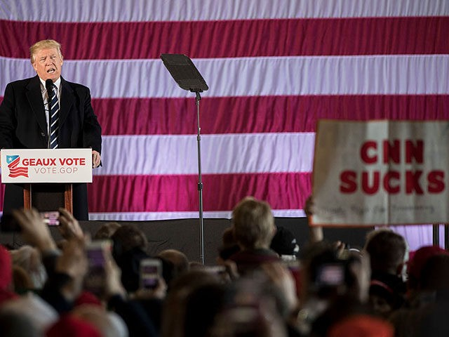 "BATON ROUGE, LA - DECEMBER 9: A sign reading ""CNN SUCKS"" is held up as President-elect Donald Trump speaks at the Dow Chemical Hangar, December 9, 2016 in Baton Rouge, Louisiana. Trump is in Louisiana to campaign for Republican U.S. Senate candidate John Kennedy. (Photo by Drew Angerer/Getty Images)"