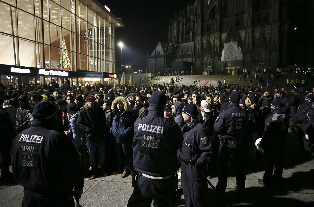 COLOGNE, GERMANY - DECEMBER 31: Police holds a group of men in front of Hauptbahnhof main railway station, where on New Year's Eve one year ago hundreds of apparently coordinated sexual assaults were perpetrated against women, prior to New Year's Eve celebrations on December 31, 2016 in Cologne, Germany. City authorities have deployed around 1,500 police officers - more than 10 times last year's number, to maintain security during this year's festivities. Security across Germany is high due also to the recent Berlin terror attack, in which suspect Anis Amri drove a truck into a Christmas market and killed 12 people. (Photo by Maja Hitij/Getty Images)